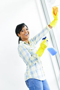 woman cleaning windows tips tricks